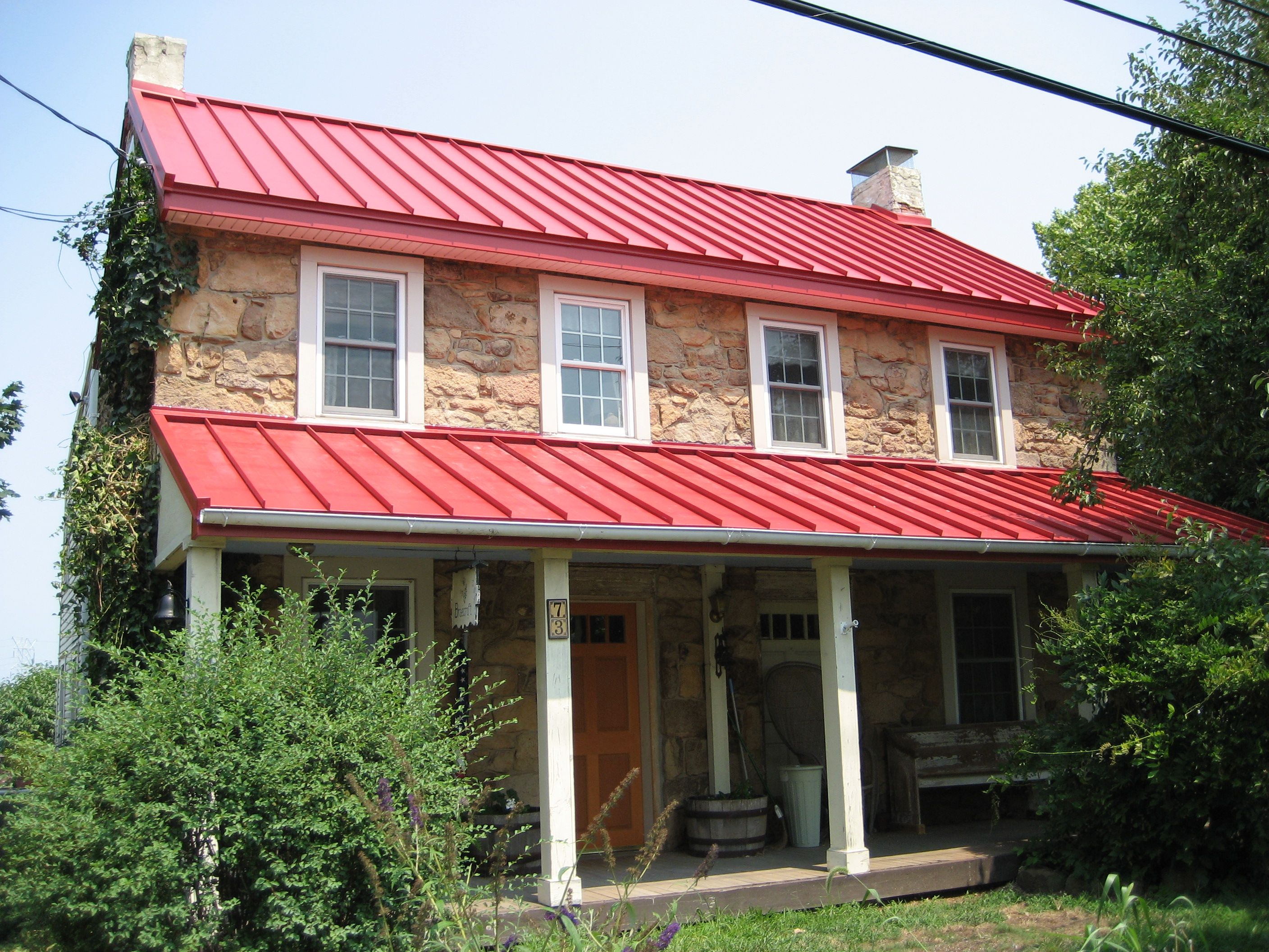 Drexel metals brilliance red metal roof metal roofs for Metal roof pictures brick house