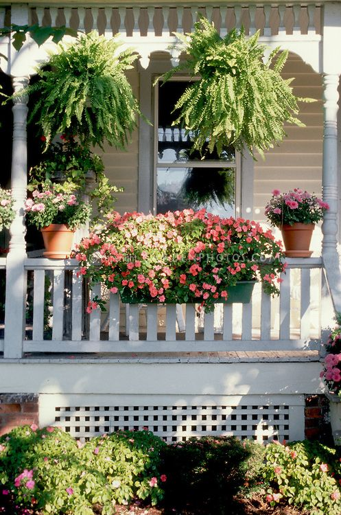Curb Appeal Container Garden On Victorian Style House