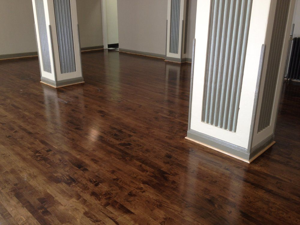 Old maple ballroom refinished and stained dark walnut for Color of hardwood floors