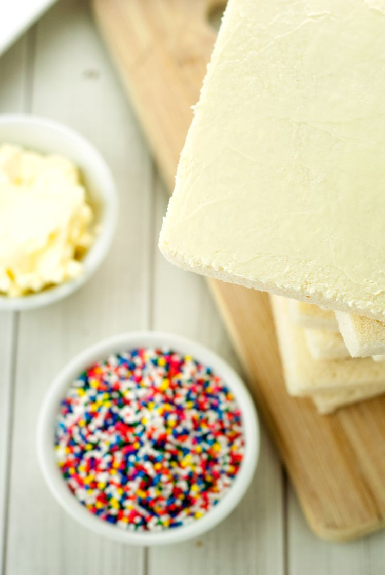 Take a trip down memory lane when you make this simple and yummy Fairy Bread, perfect for children's parties or just for fun! Sprinkles make it perfect!