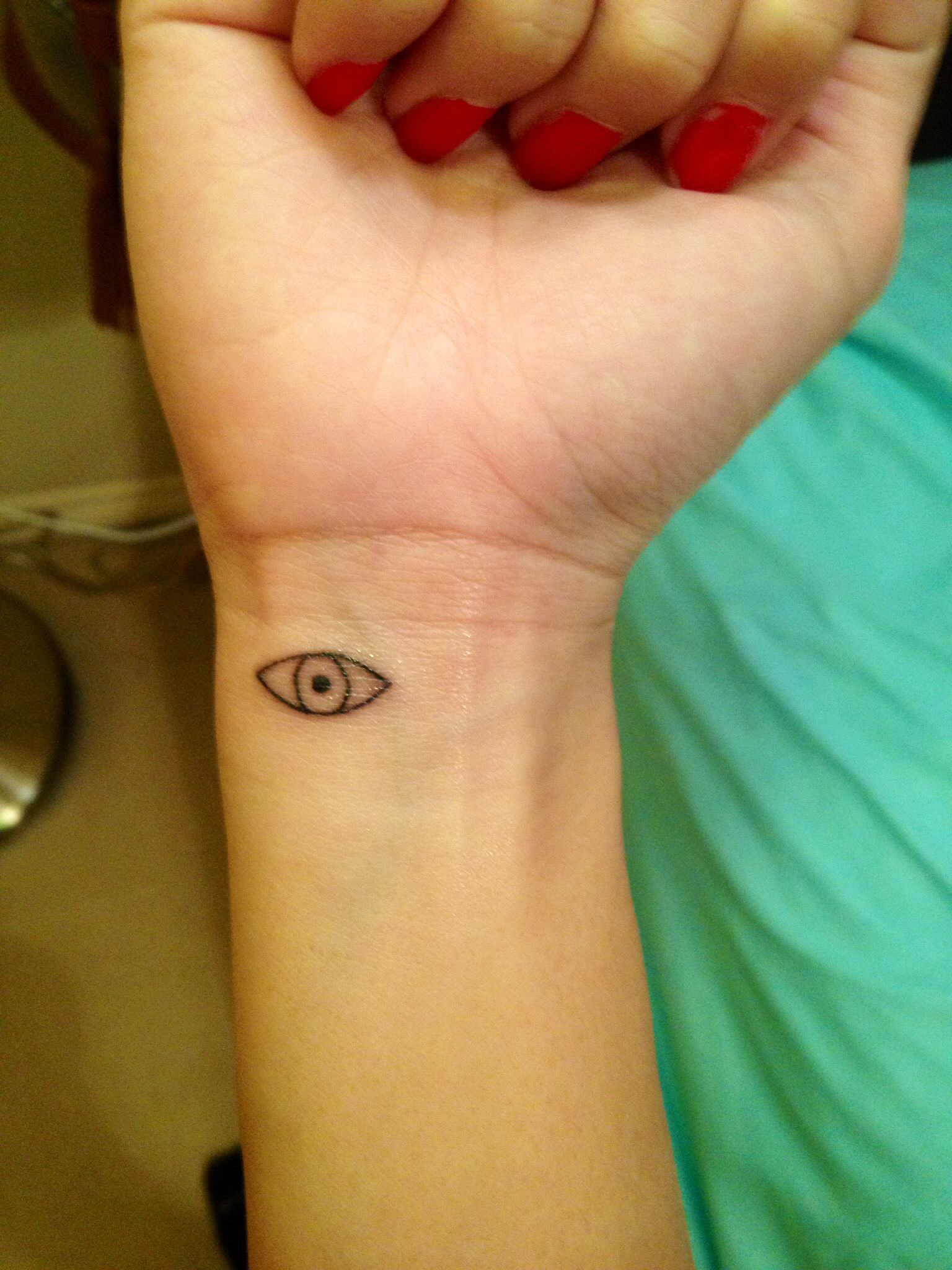 Evil Eye Tattoo (With images) Evil eye tattoo, Wrist