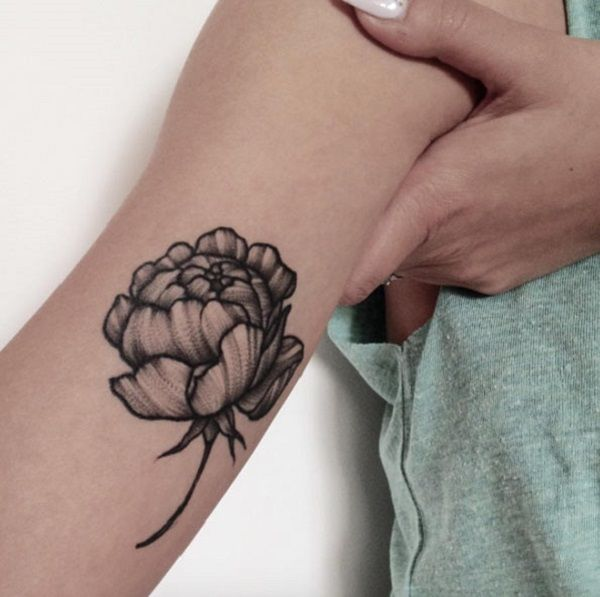 This peony tattoo on the arm is simply beautiful. No colors, no details, yet an amazing decent and graceful choice for you.