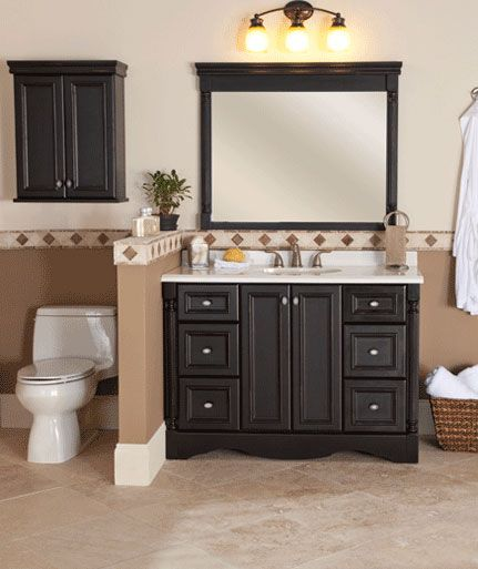 For your smaller master bathroom, try the Valencia 48in vanity cabinet. The sturdy cabinet features a hand-painted antique black finish that has just a hint of patina for a subtle distressed look. You can add a custom top and optional wall storage and a mirror for a complete suite!