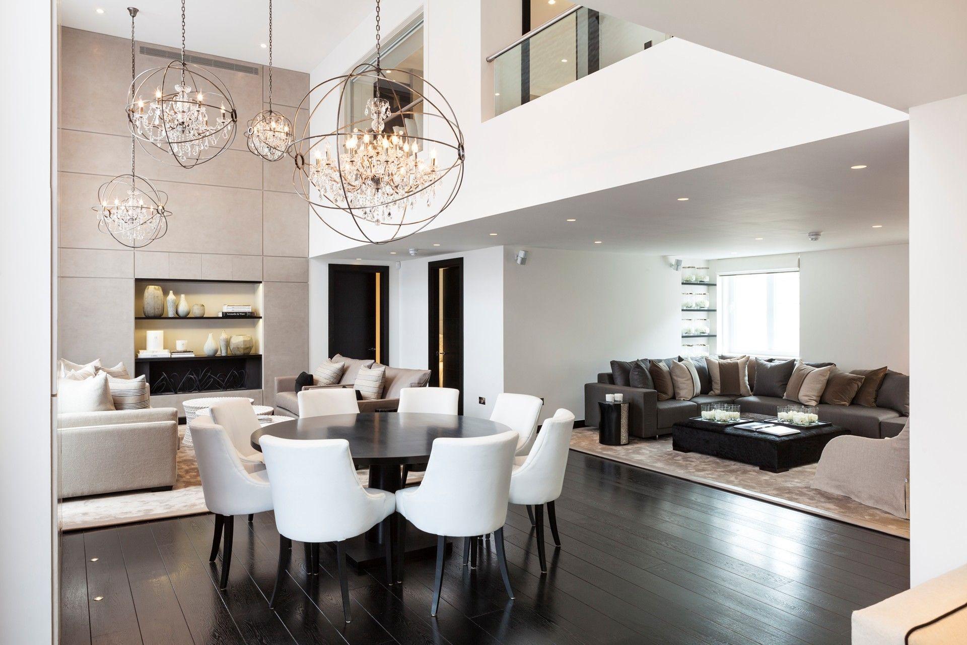 Elegant chandeliers dining table living space open plan henrietta street apartment