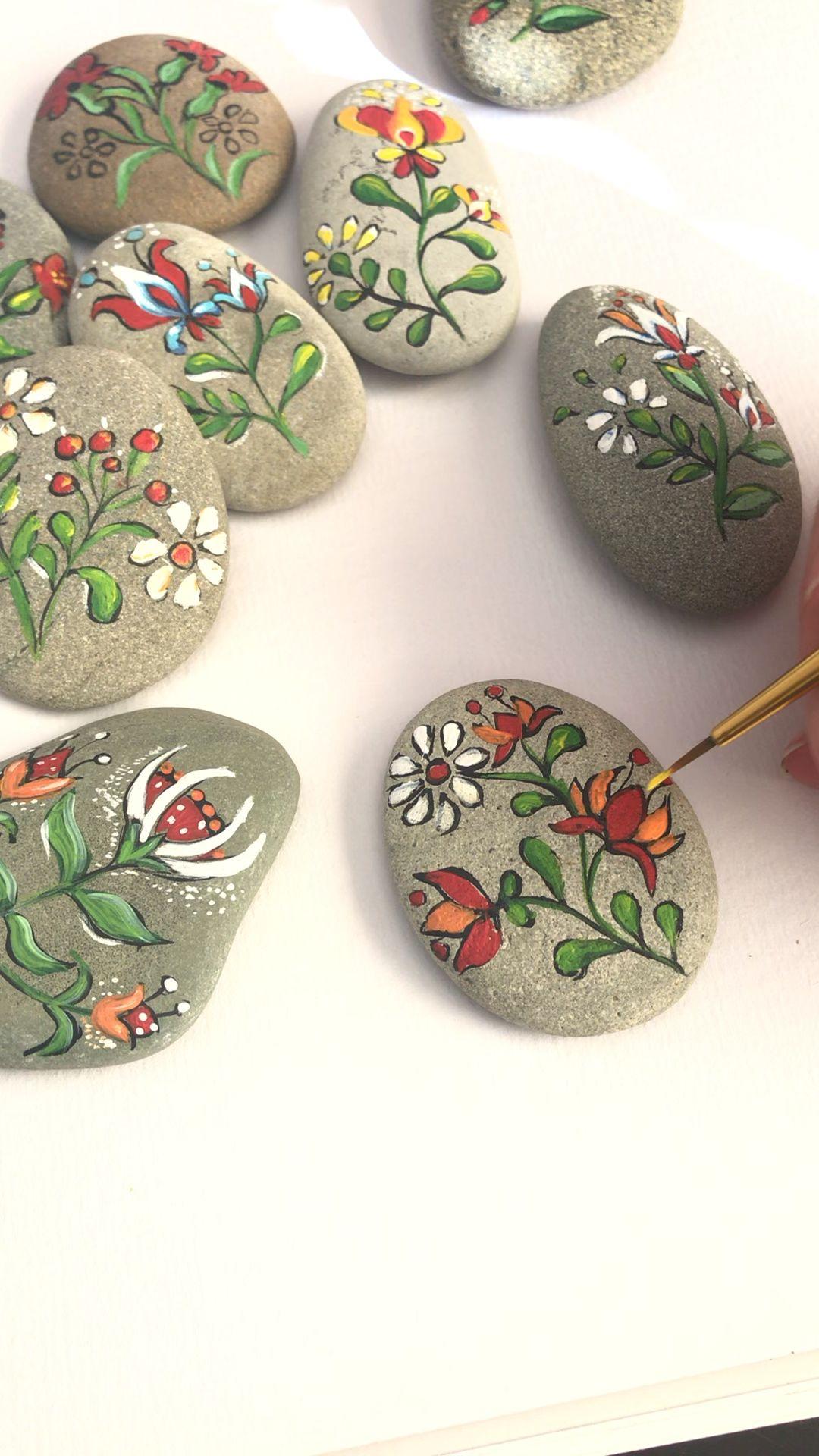 Photo of Folk art flowers painted pebbles by Christine Onward