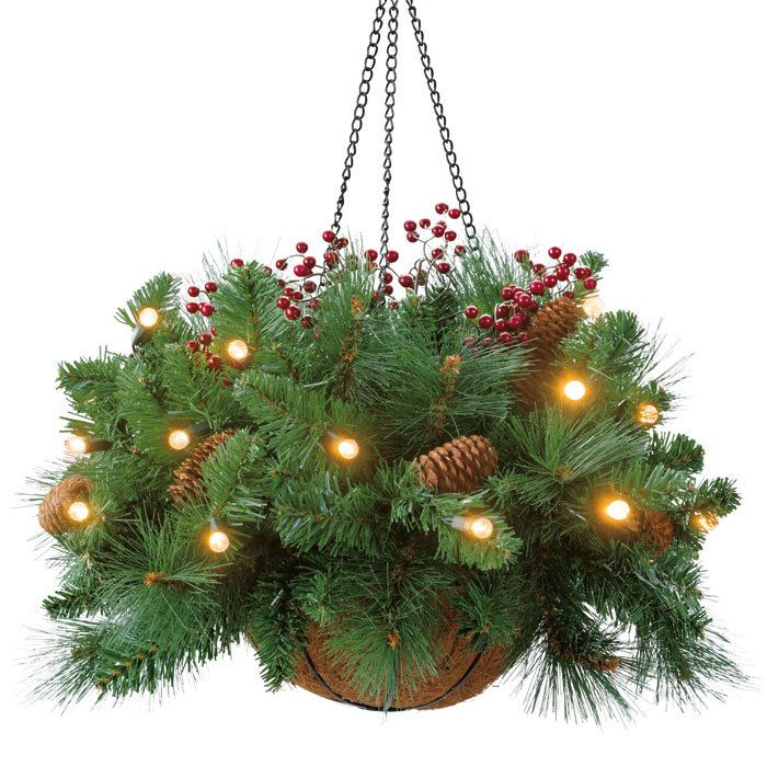 A hanging basket with pine tree branches (or any Christmas ...