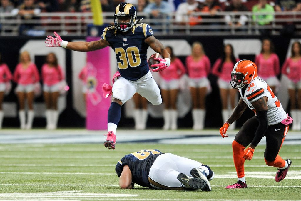 Todd Gurley #30 of the St. Louis Rams leaps over teammate ...