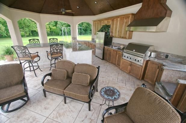 Perfect patio for us.  Hubby would love that grill! @Eric Washington