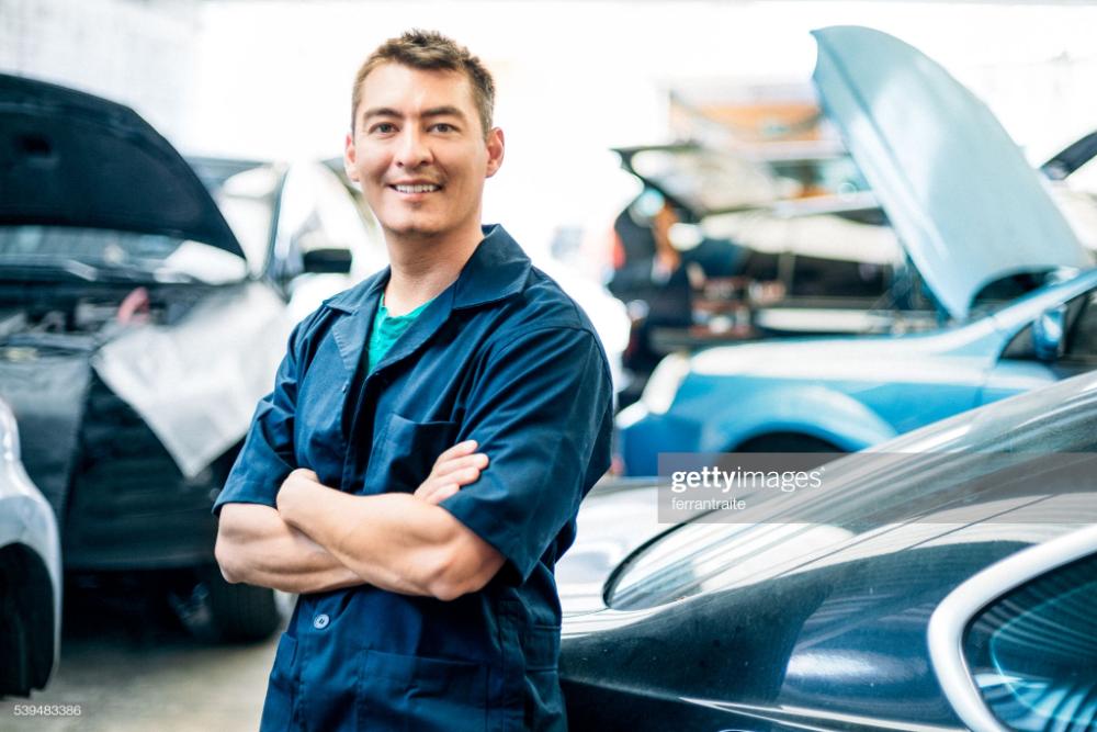Portrait Of A Mexican Car Mechanic In Auto Repair Shop Auto Repair Shop Auto Repair Auto Repair Estimates
