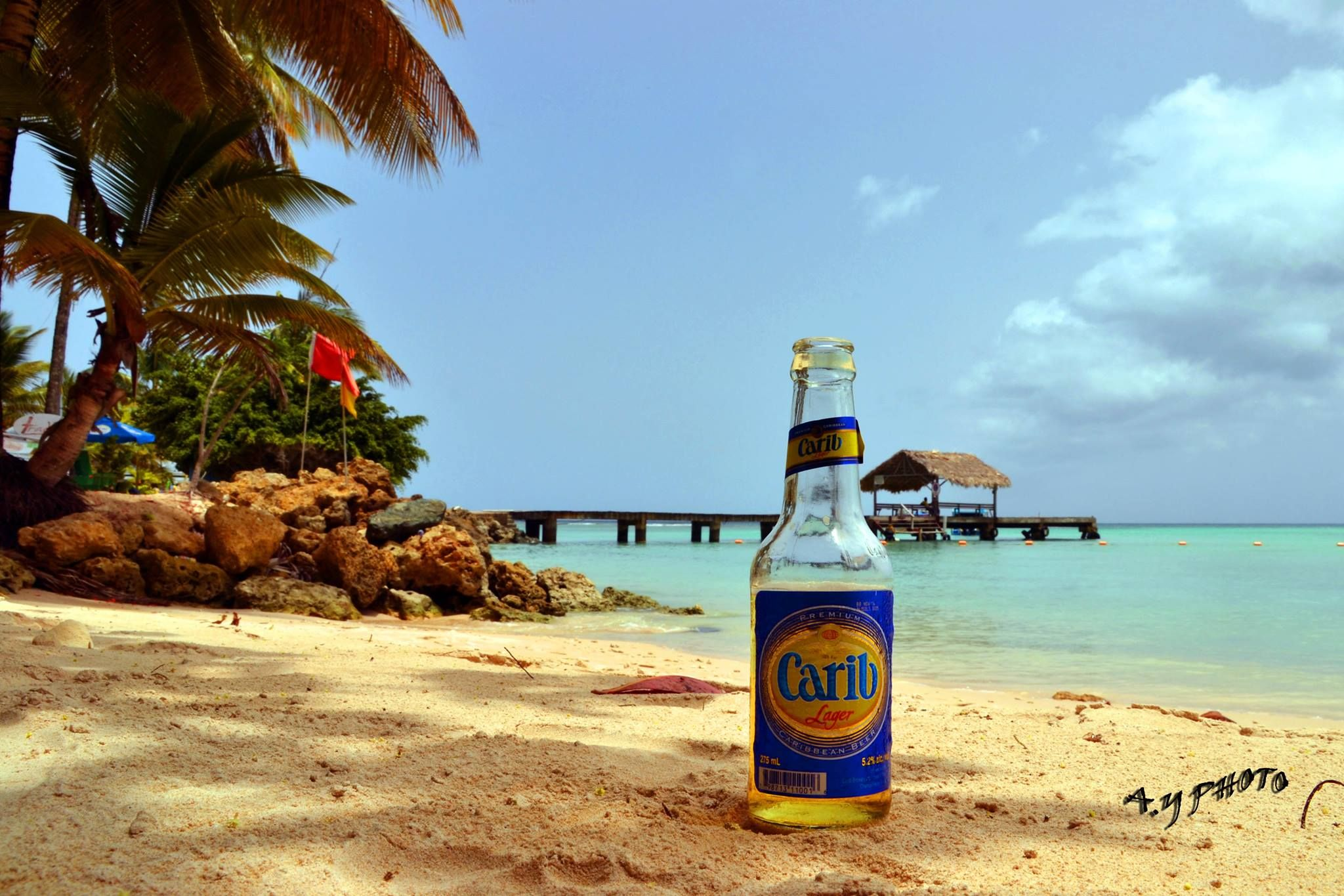 The only thing that can beat a cold beer on the beach is...a cold #Carib #beer at the Pigeon Point Heritage Park in #Tobago. Photo courtesy: Ayanna Young