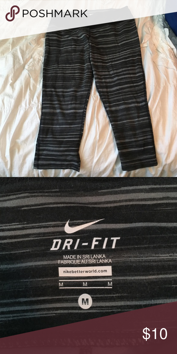 Nike cropped leggings Grey stripped. Cropped. Soft material. Good condition Nike Pants Leggings