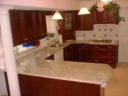 colonial kitchen cabinets | cabinets, in burgundy finish, add an