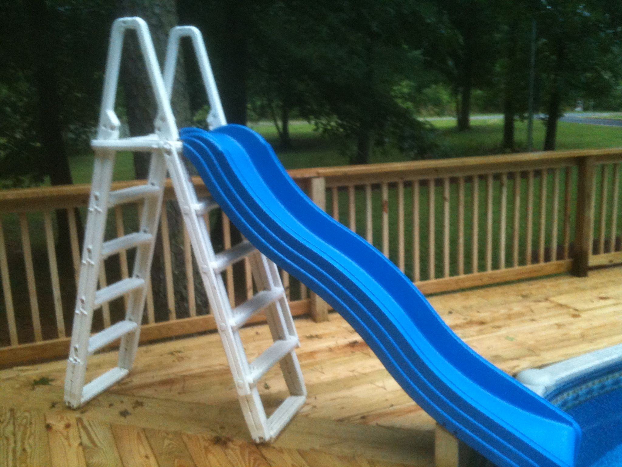 diy above ground pool slide swimming pool my wife found the slide at yard sale it is playground slide attached to our old pool ladder did this over weekend sale
