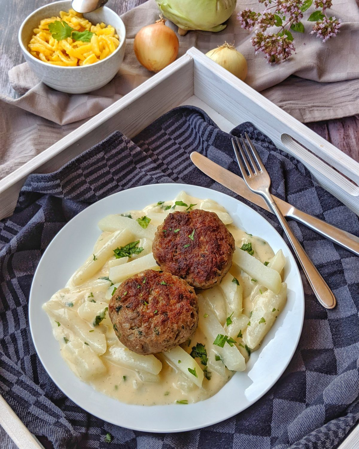 Photo of Cabbage greens in light sauce with meatballs and spaetzle