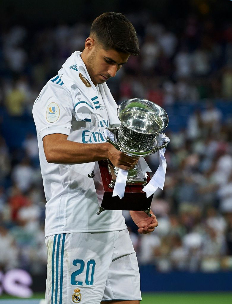 Marco Asensio of Real Madrid celebrates with the trophy ...