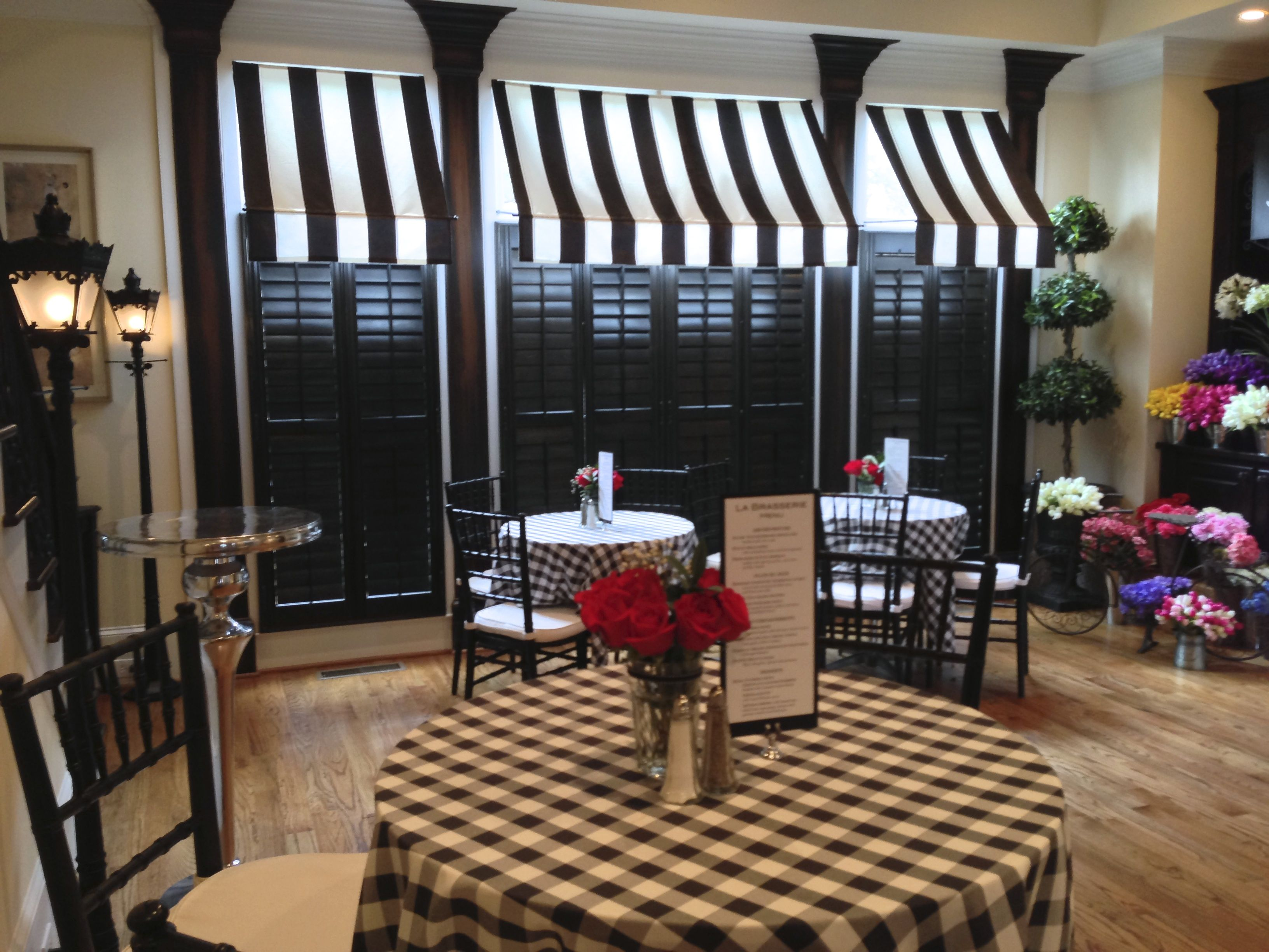 Black And White Awnings Created The Feel Of A Parisian