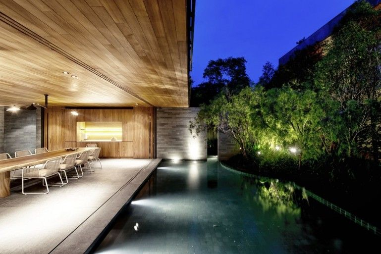 The Wall House Looking out onto the pool at night (Photo: Bryan van der Beek and Edward Hendricks)