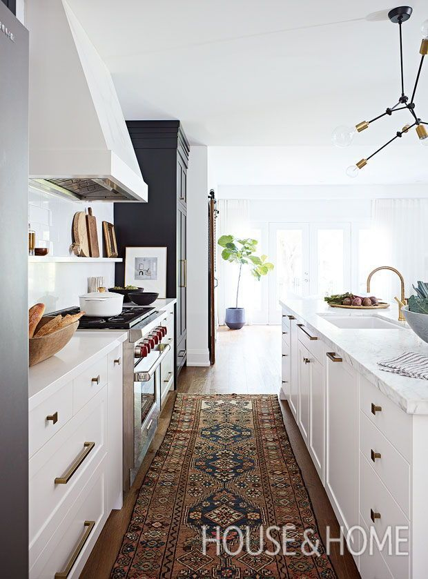 Makeover: A Galley Kitchen, Transformed! Designer Erin Feasby of Feasby & Bleeks Design converted a galley kitchen into an open space complete with a dining area and loads of personality. | Photographer: Angus Fergusson #whitegalleykitchens Makeover: A Galley Kitchen, Transformed! Designer Erin Feasby of Feasby & Bleeks Design converted a galley kitchen into an open space complete with a dining area and loads of personality. | Photographer: Angus Fergusson #opengalleykitchen