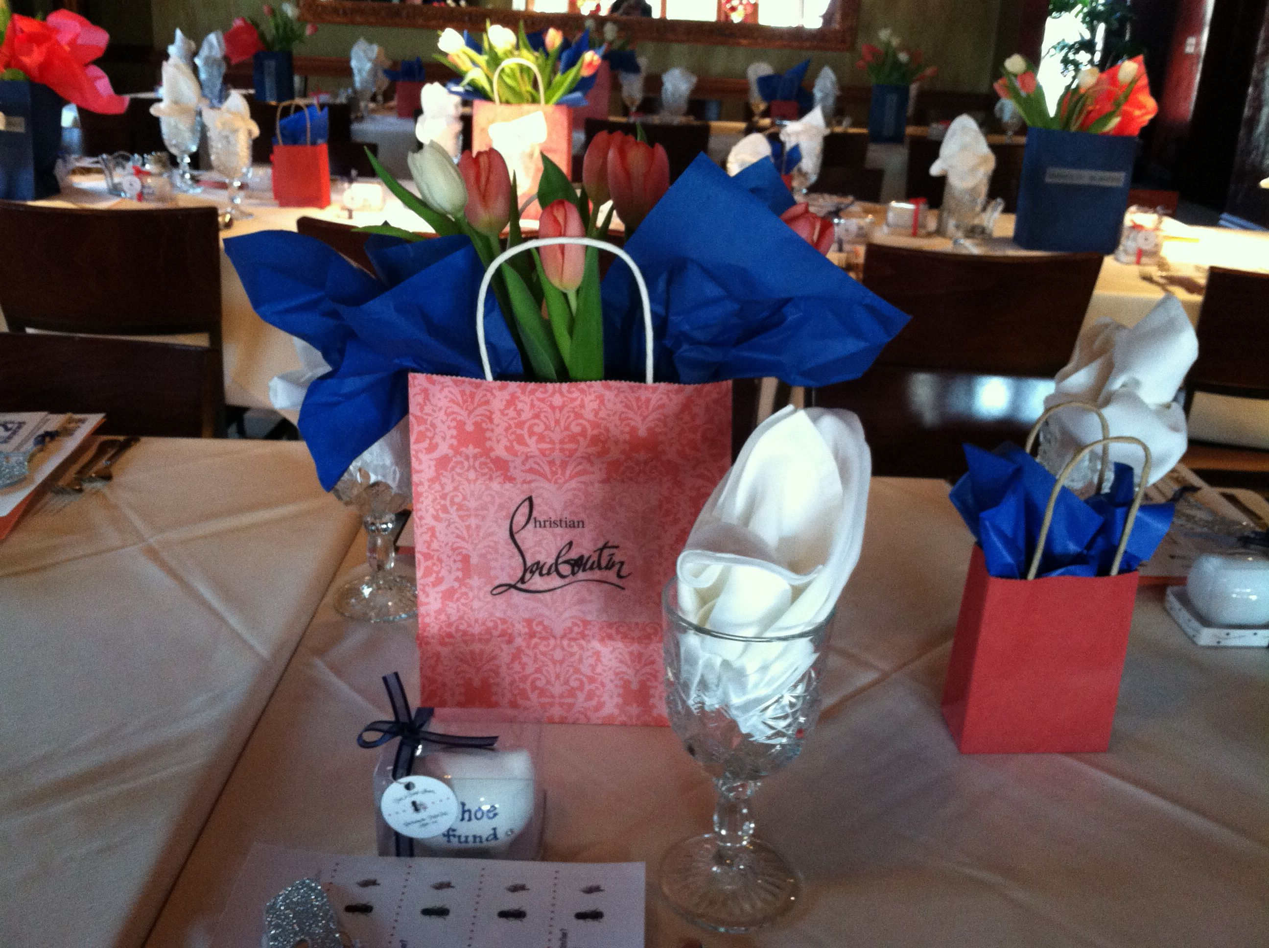 Shoe theme for my daughters bridal shower.  We took designer logo's and put them on shopping bags stuffed with tulips