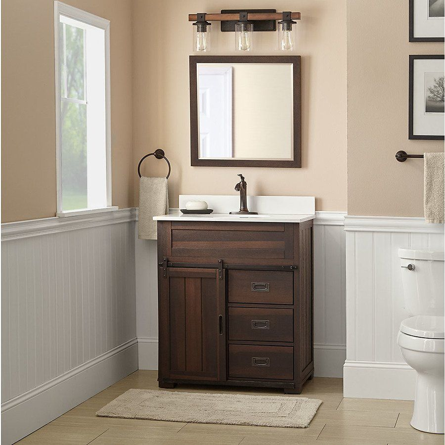 Give your bath a fresh update with a new vanity. This distressed wood  single sink vanity packs plenty of storage and features unique barn door  style ...
