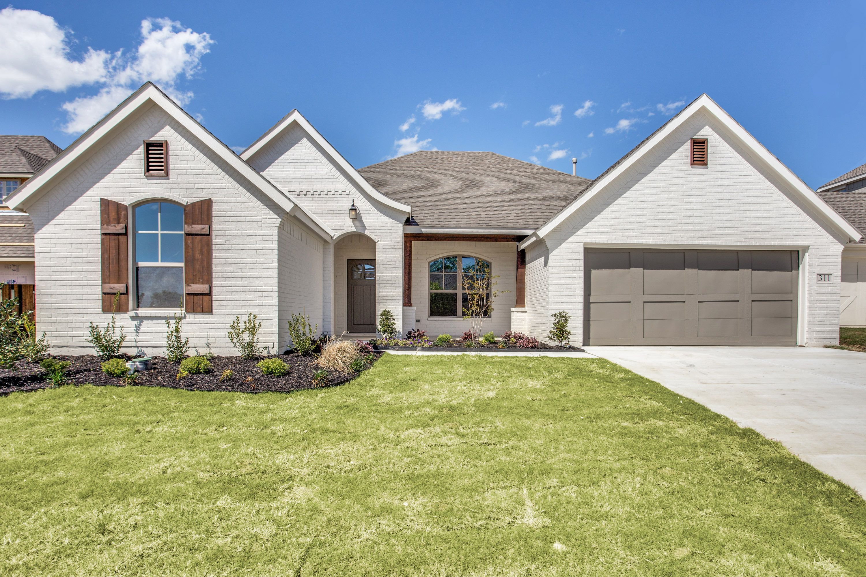 Clarity Homes Fort Worth White Painted Brick Home Gray Accents Stained Shutters Better