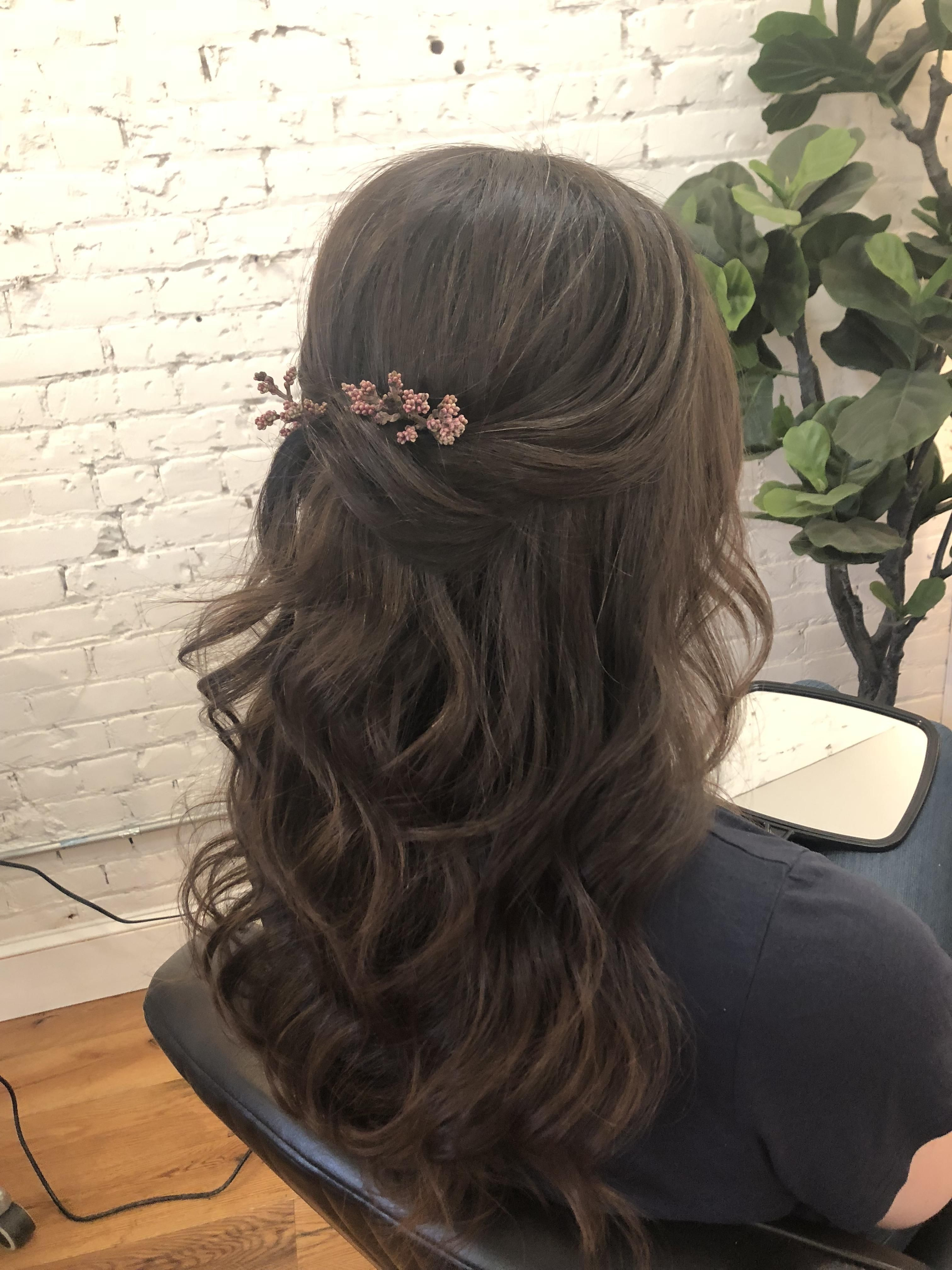 Half up half down wedding hair with subtle greenery wedding