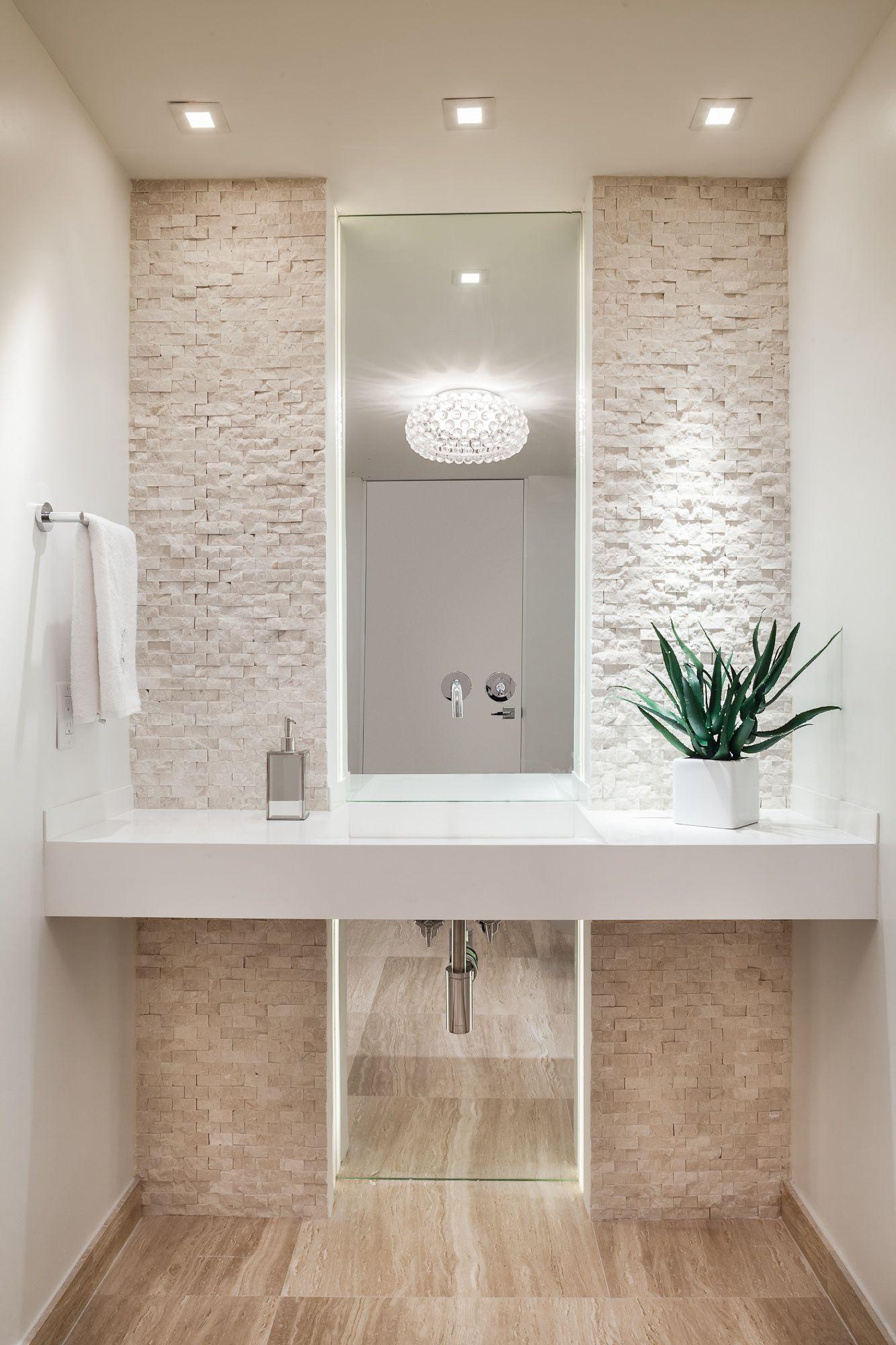 Project by 2id interiors - South Beach   Amazing powder room. Simply elegant. Mirror, stone walls, LED lighting, Travertine Floor.