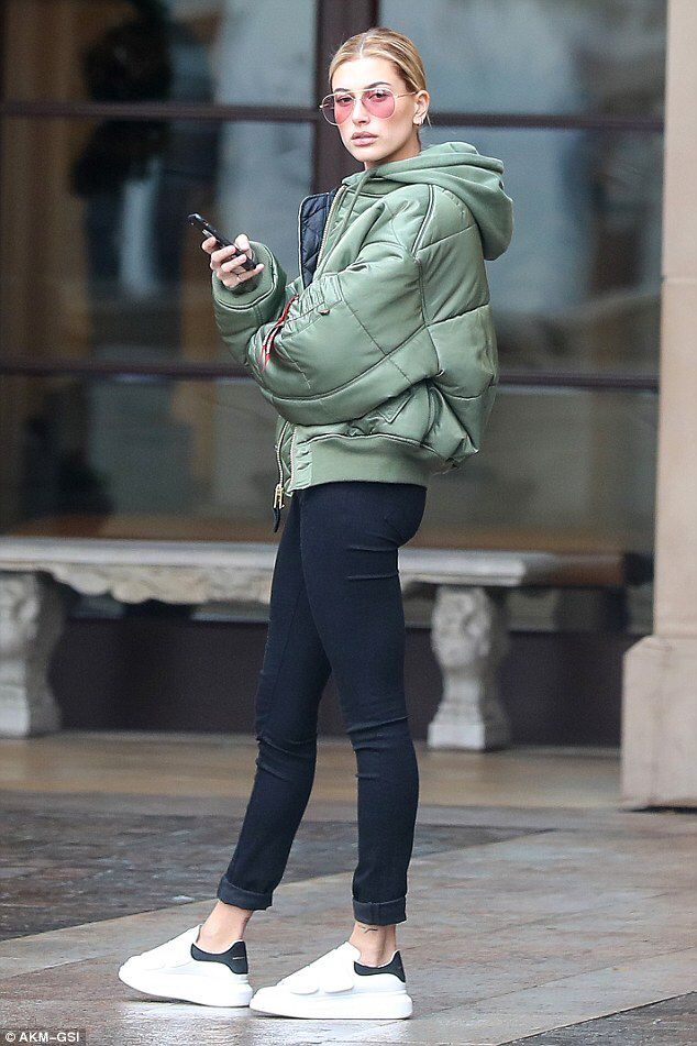 8a86a52509 Hailey Baldwin steps out in green jacket and skin tight trousers  dailymail