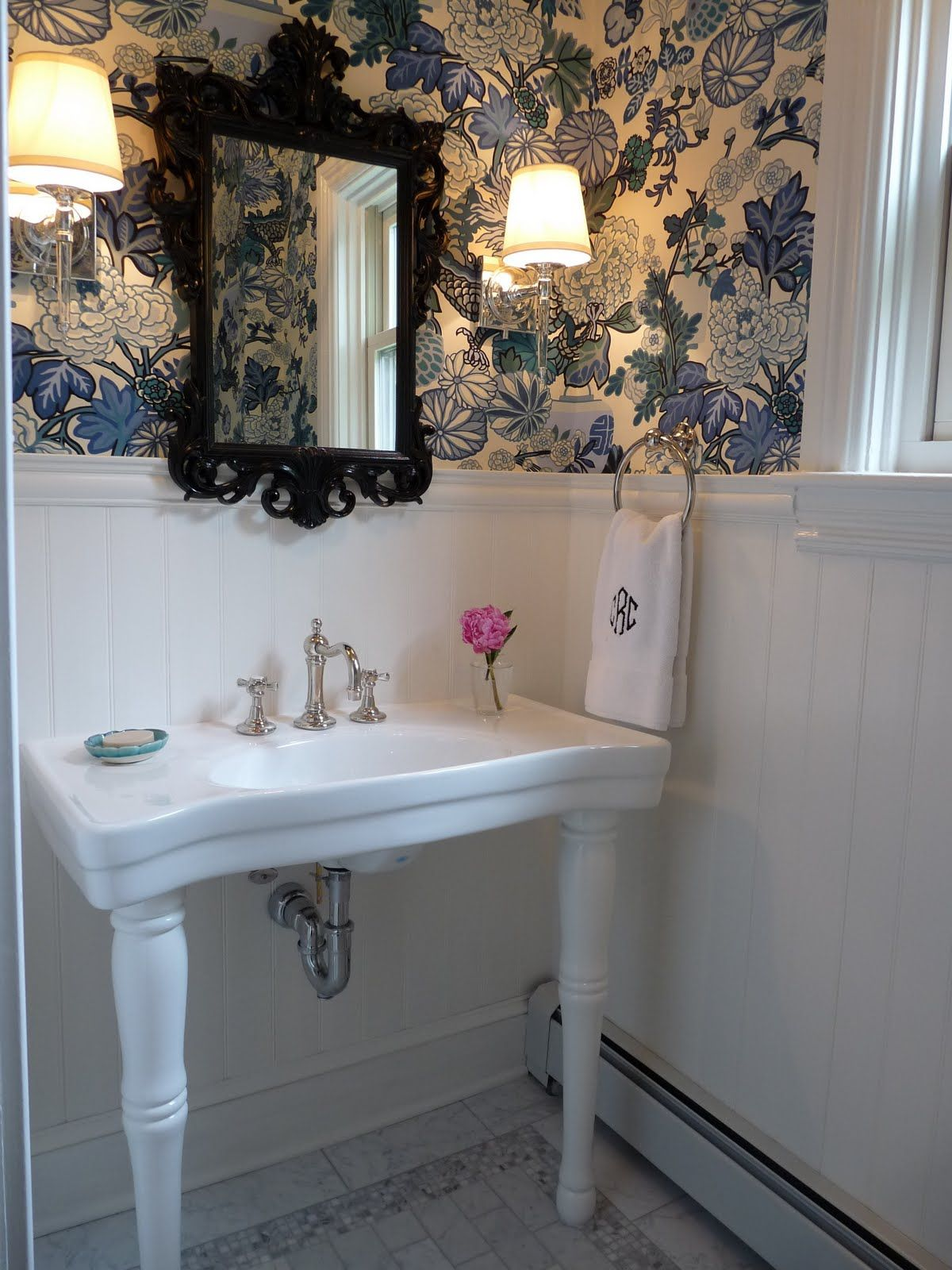Powder room with blue floral wallpaper and beadboard via Carrie