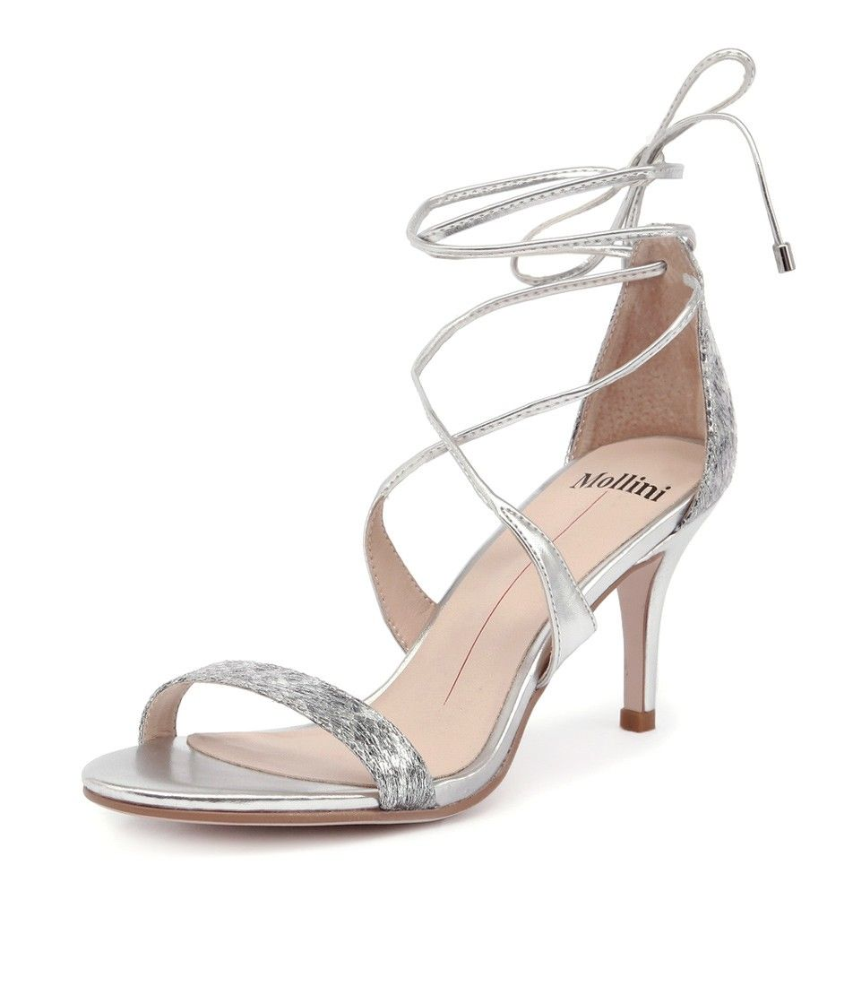 2072fafcaca9 This wrap around heel is super flattering and will make bare legs look  runway-worthy