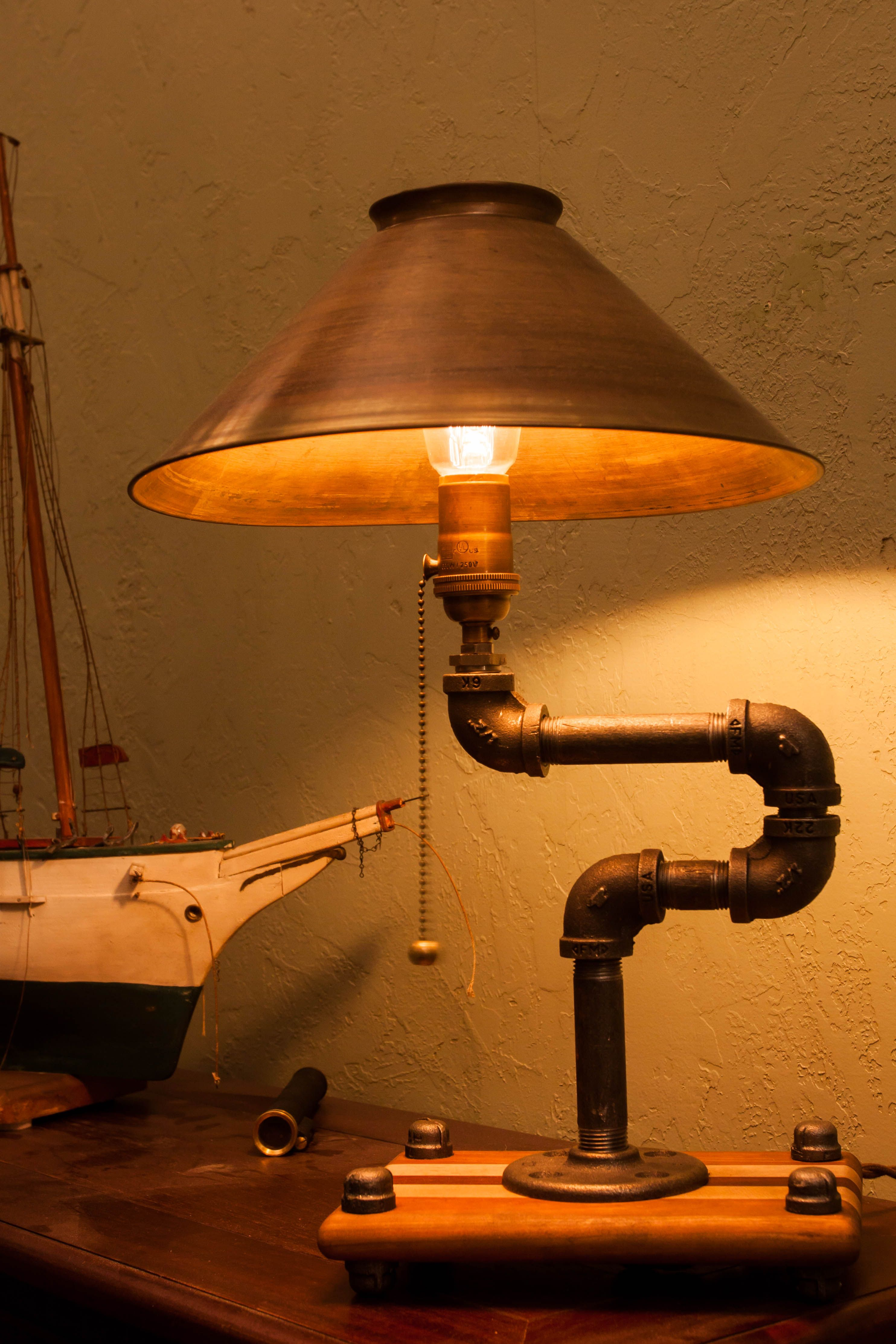 The Lounge Made With Usa Pipping And A Hardwood Base An Interesting And Yet Pleasant Lamp A Fine Add Wooden Lamps Design Steampunk Lighting Rustic Lighting