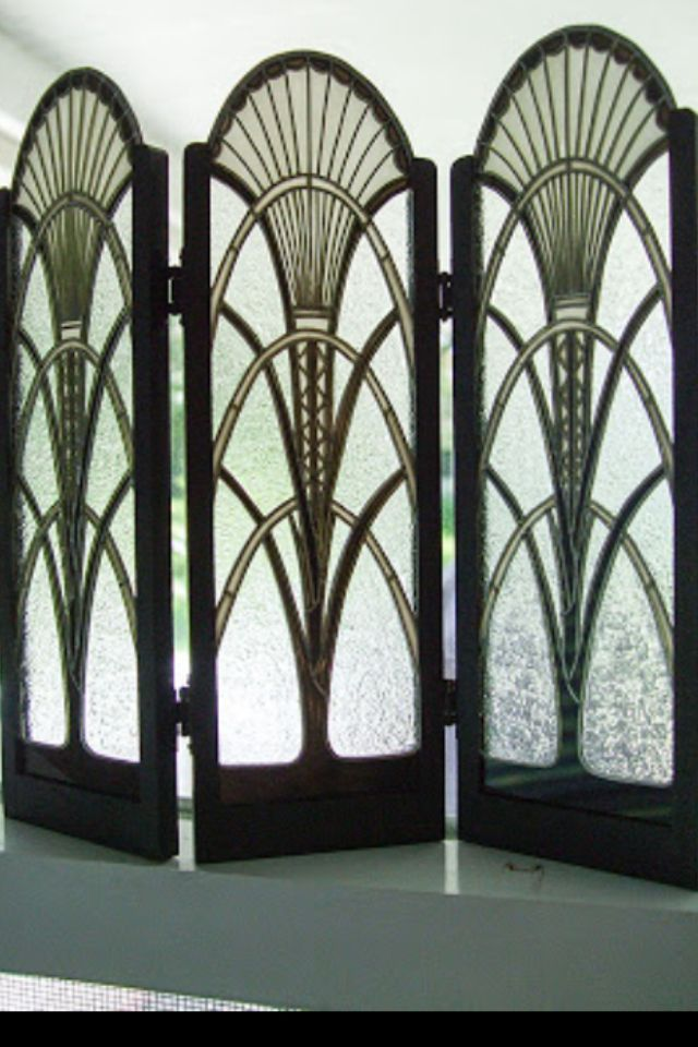 Art Deco Screen, sun motif and triangular patterns can be seen. The  sweeping cur