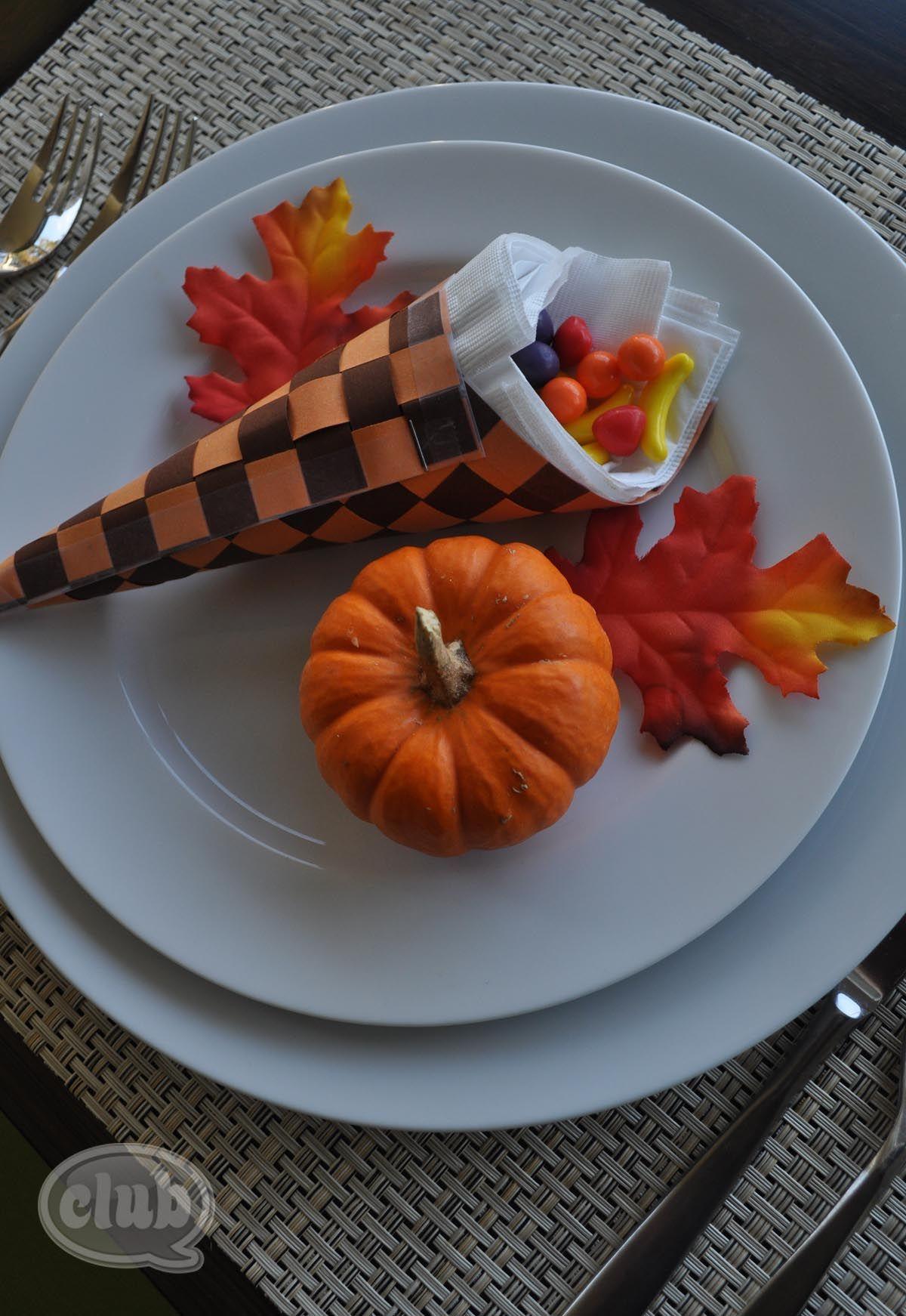 cute table setting - weaved paper cornucopia stuffed w/napkins and runts