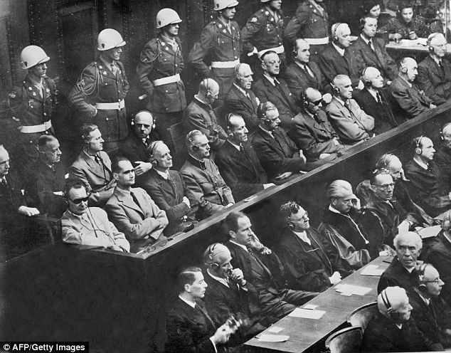 At the Nuremberg war crimes trials (pictured), the Gestapo was branded a 'criminal organisation' responsible for 'crimes against humanity'. Yet no major collective Gestapo trial was held