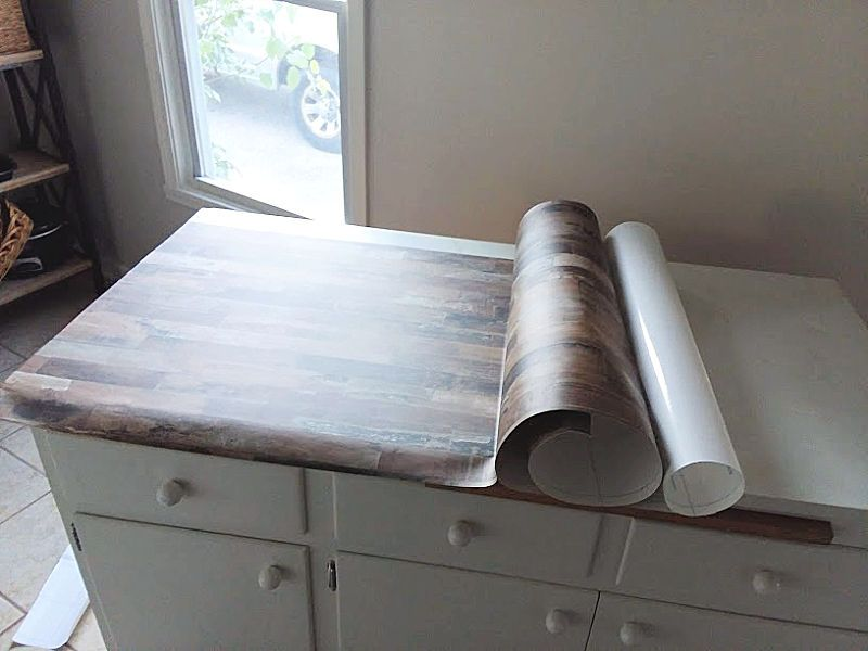 Make A Faux Wood Countertop With Peel And Stick Wallpaper Stow Tellu Countertop Makeover Wood Countertops Wallpaper Cabinets