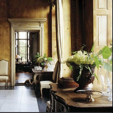 timeless feeling created by the high ceilings, aged walls (plaster finish), heavy molding