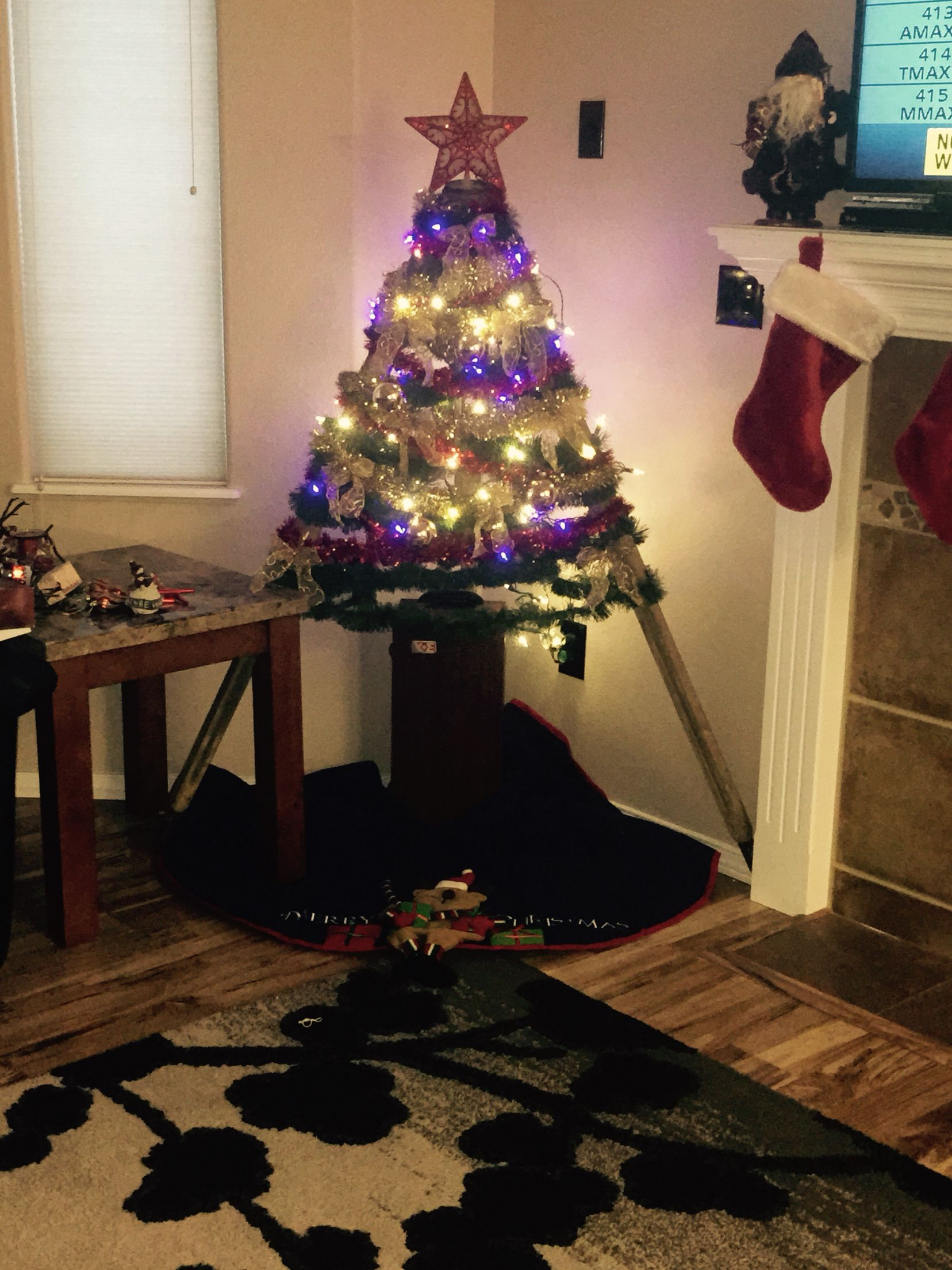 Make shift Christmas tree with multi colored garland ...
