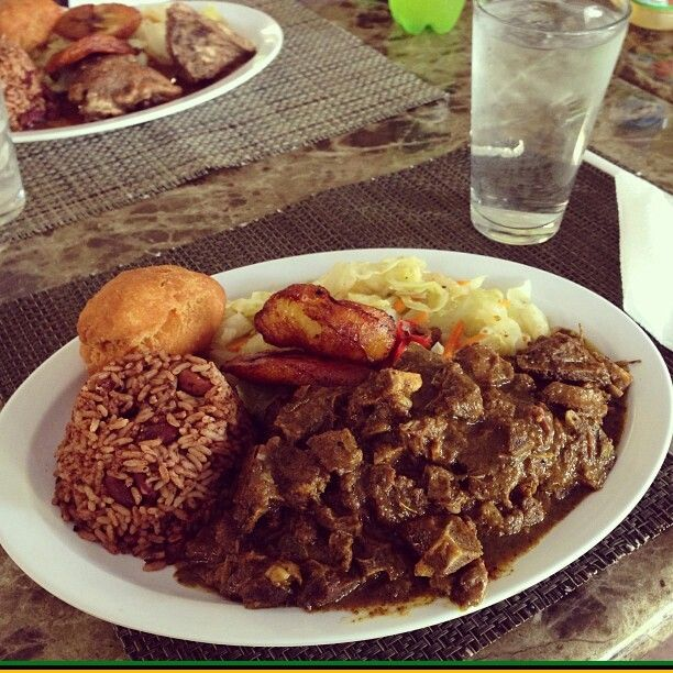 curried goat rice and peas fried dumpling fried