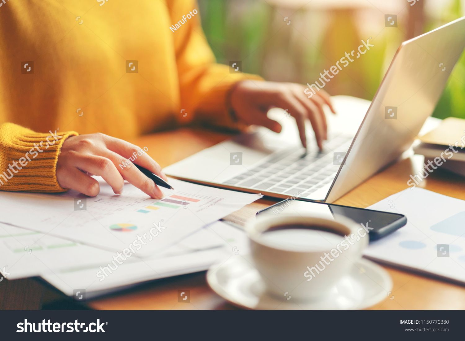 Young Serious Accountant Woman Checking Paperwork From Accounting
