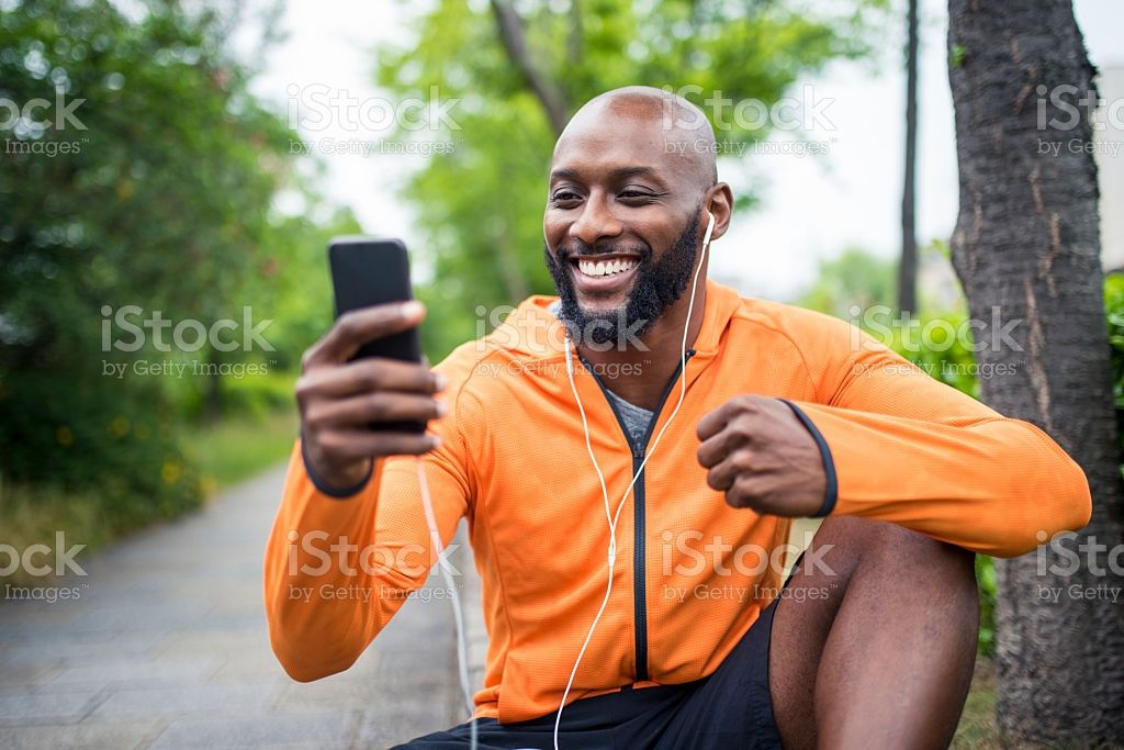African american man sitting outdoors before his training