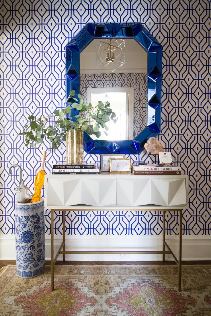 A blue and white entry way features a modern white console table a blue and white entry way features a modern white console table a blue mirror geotapseo Images