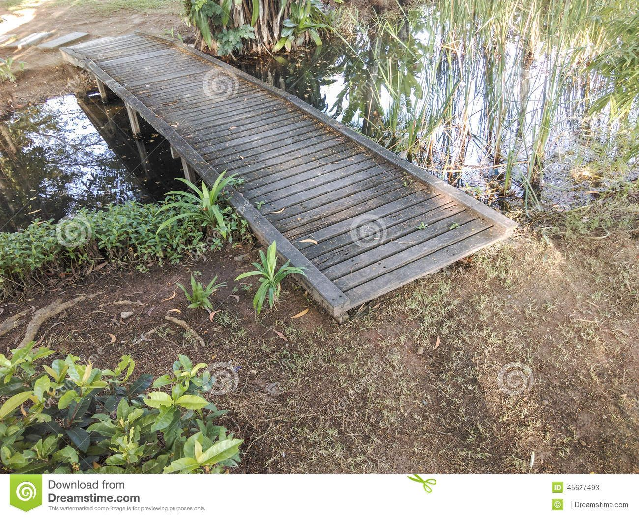 Small Pond Bridges Small Wooden Bridge Over A Pond Stock Photo