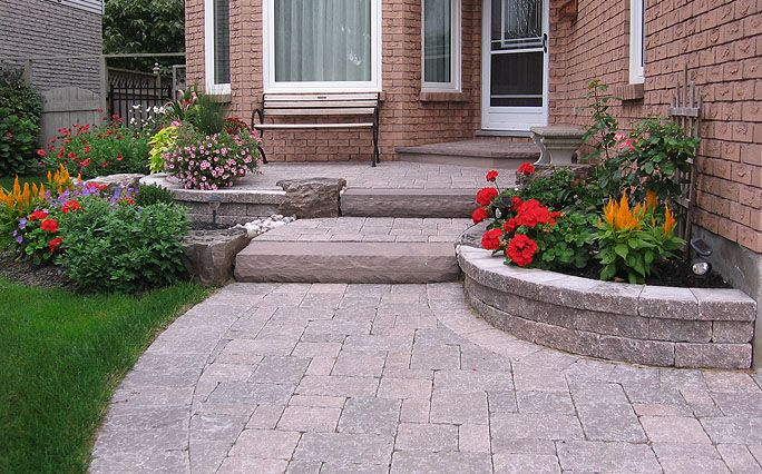 Red rose landscaping interlocking brick retaining walls for Red brick patio ideas