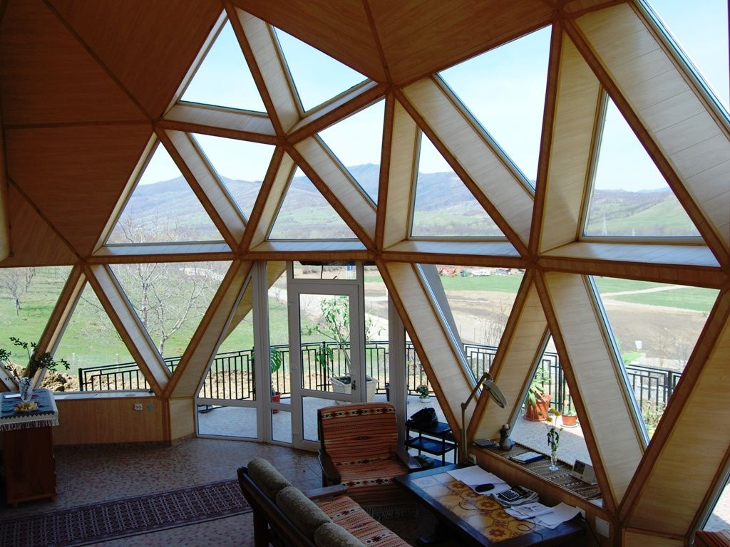 A mountain view from the interior of a geodesic dome in Prahova, Romania.