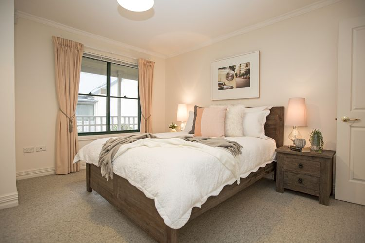 Gentil Guest Bedroom, Dark Timber Bed And Matching Bedside Tables, Pink Cushion,  Faux Fur