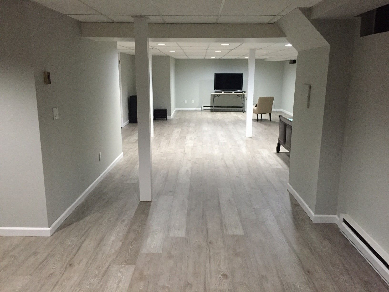 jose g upgraded his basement with kronoswiss ecru laminate flooring using express flooring. Black Bedroom Furniture Sets. Home Design Ideas