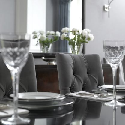 Beautiful Gray Chic Dining Room Design With Tufted Chairs Glossy Black Lacquer Table Mirror And Walls
