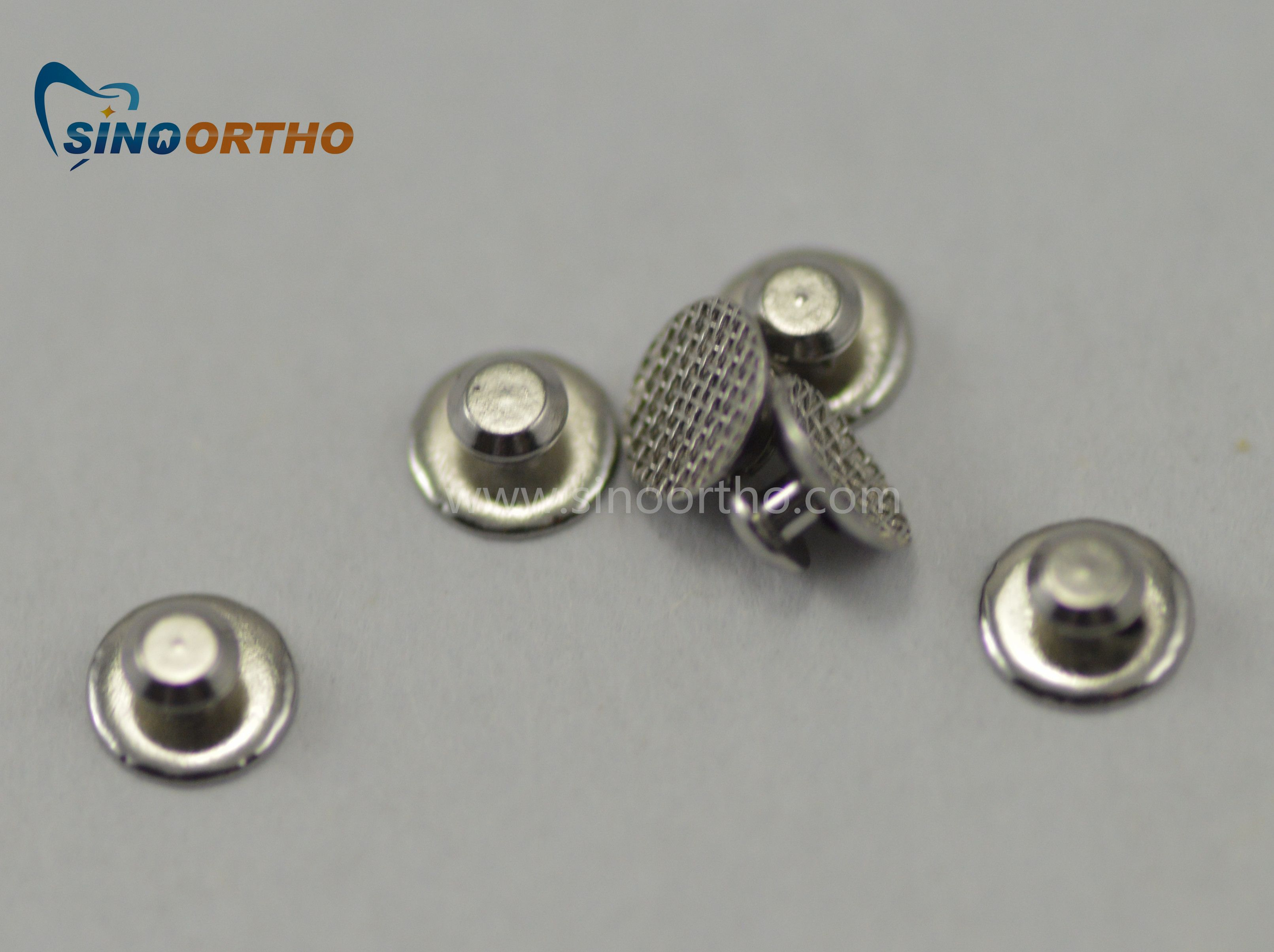 SINO ORTHO Lingual Button , Hot Sale Mesh Base , Bondable Have A Good  Bonding Ability , Good Quality , Door To Door Service , Get Your Products  At Home .