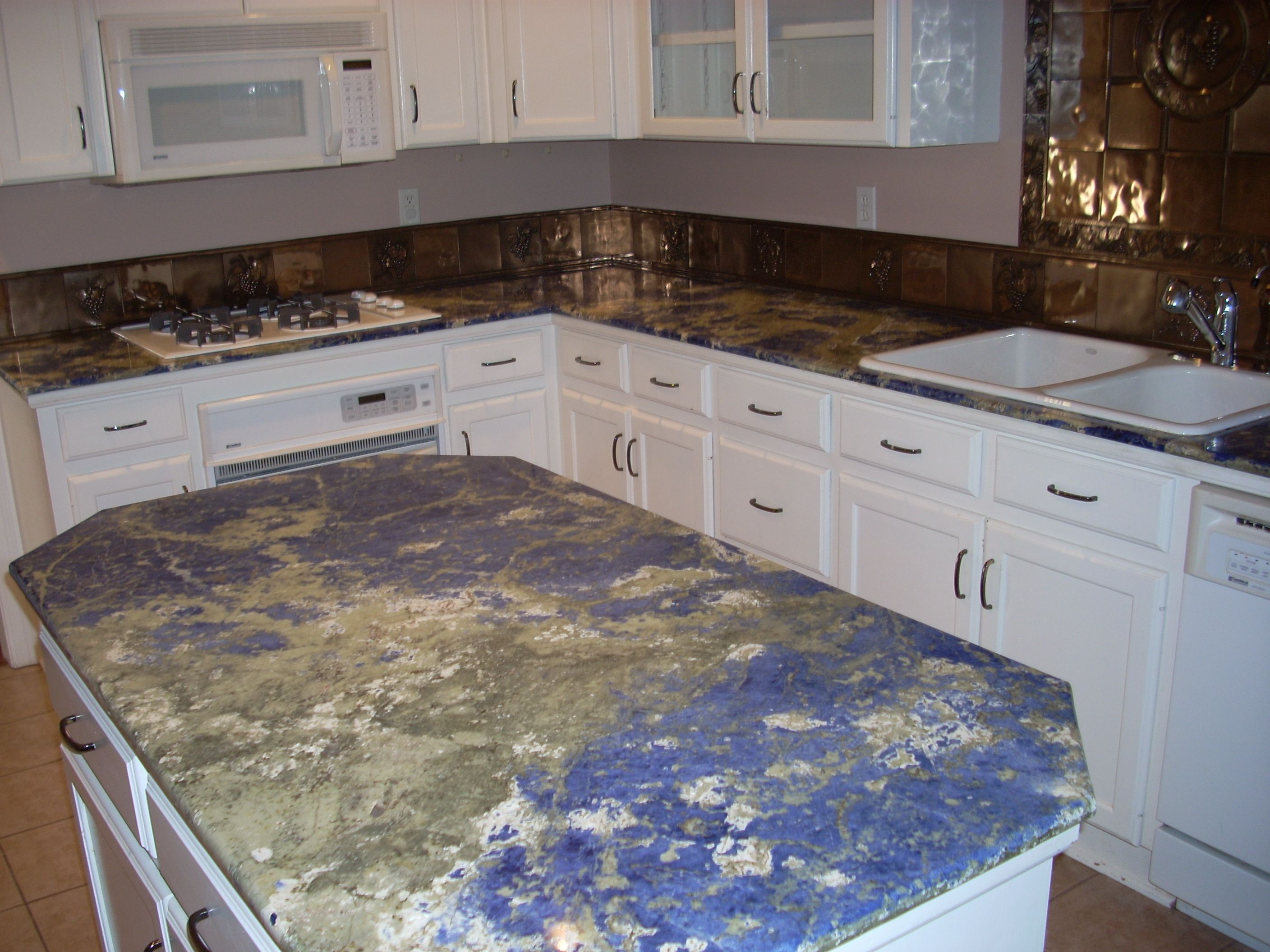 Sodalite Blue Granite Countertops Amazing Texture Variation Looks Blue Granite Countertops Blue Kitchen Countertops Countertops
