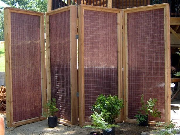 DIY experts demonstrate how to add a bit of privacy to a hot tub with a  four-panel screen lined with thick mesh fabric.